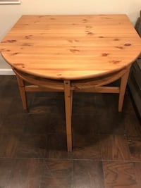 round brown expandable wooden table