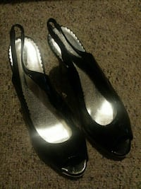pair of black and silver ling back heels.Size 61/2 Green Bay, 54303