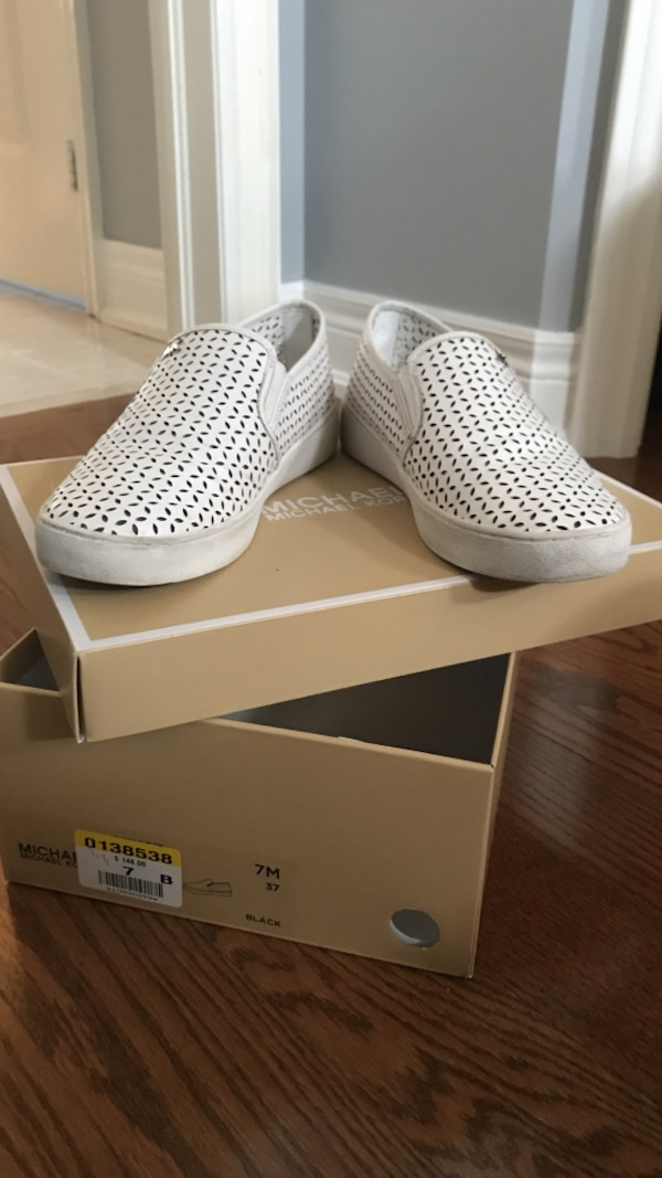 pair of white-and-brown slip-on shoes with box