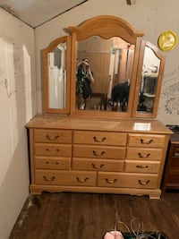 Dresser with a large mirror