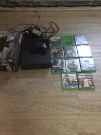 black Xbox One console with controller and game cases Calgary, T2A