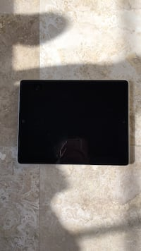 black iPad with black case 30 mi