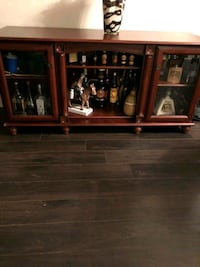 brown wooden framed glass display cabinet Toronto, M6E 2N8