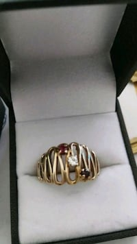 gold-colored ring with red, clear, and black gemstones and box Annandale, 22003