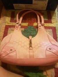 women's pink and white leather handbag 44 km