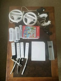 white Nintendo Wii console with controllers and game cases Warsaw, 28398