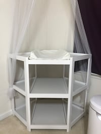 White wooden corner changing table with canopy. Brand new goes for 130 minimum. Paid 135.00, asking 55. No scratches, dents, or stains. Smoke free home. Winchester, 22602