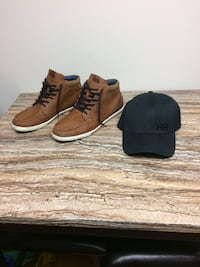 Pair of brown acg leather chukka boots and black fitted cap