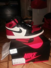 pair of black-and-red Nike basketball shoes New York, 10033