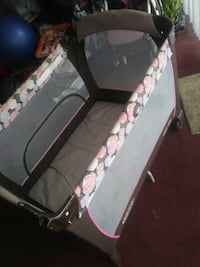 Baby pack and play pink and tan floral design Jacksonville