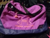 pink and gray Under Armour duffle bag