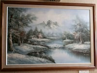 body of water near mountain painting with brown wooden frame