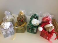 4 various small stuffed animals holding small Christmas ornament