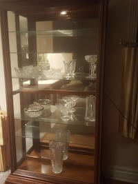 brown wooden display cabinet with clear glass cups Shreveport, 71108