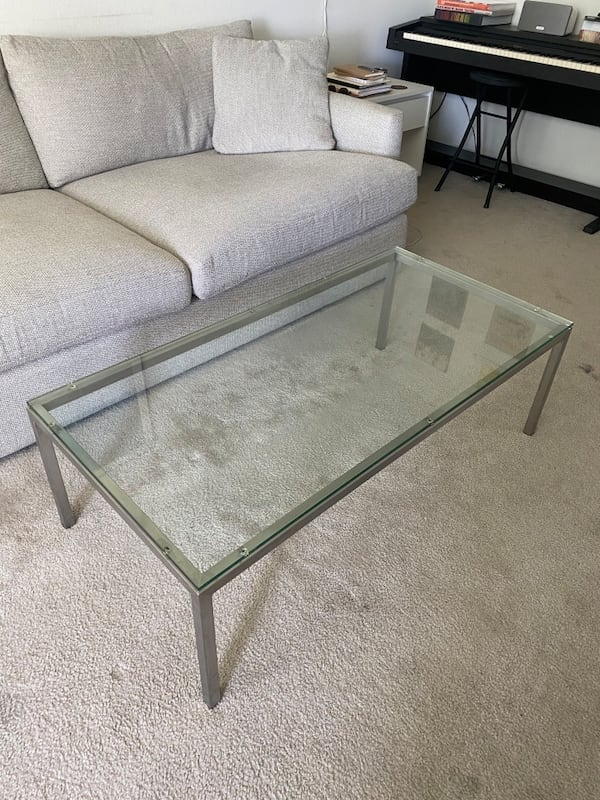Glass coffee table with metal / stainless steel base d3121f88-d2f5-4e8a-a9d2-d0a704ffd8de