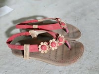pair of brown-and-red sandals 775 km