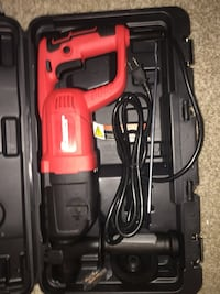 red and black corded power tool with case Houston, 77082