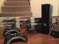 Xbox 360 with 28 games and 2 controllers.