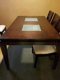 Rectangular brown wooden table with six chairs Mississauga, L5A 3K8