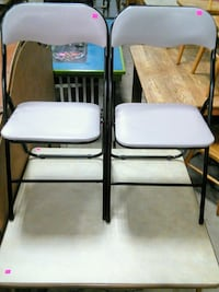 Card table with folding chairs.