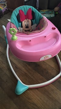 baby's pink and white Bright Stars Minnie Mouse walker
