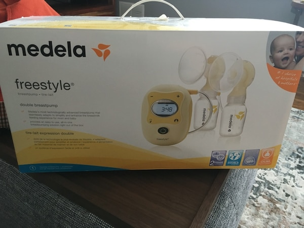 white and yellow Medela breast pump box