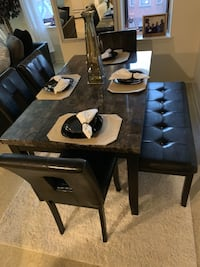 Black and brown marble top dining table set