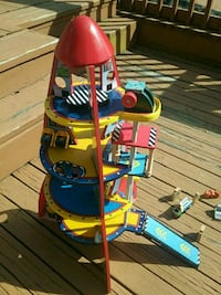 Wooden Spaceship toy with moveable parts.