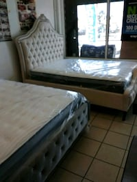 brown wooden bed frame with white mattress Los Angeles