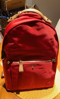 Michael Kors red backpack never been used still has tag Oxon Hill, 20745
