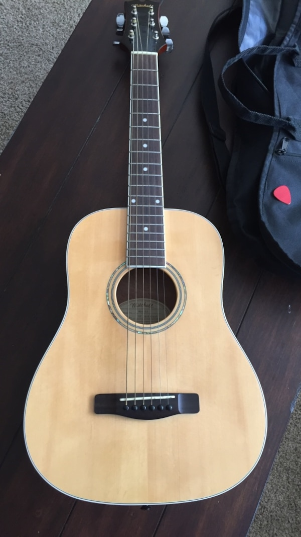 Black and brown acoustic guitar child's size