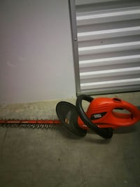 red Black & Decker electric hedge trimmer 49 km