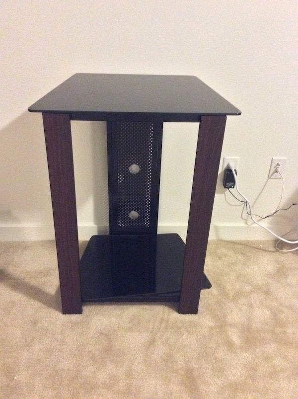 Black wooden single tv stand or side table that has two shelves