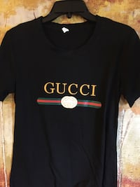 Gucci T-shirt brand new says large but cut more like medium Baltimore, 21201