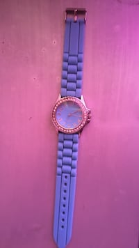 round silver analog watch with blue strap