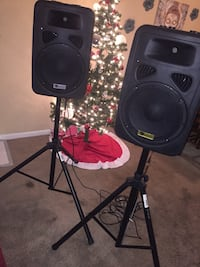 two black PA speakers with stand 1206 mi