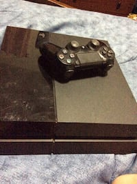 black Sony PS4 console with controller New York, 11208
