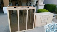 brown wood-framed clear glass cabinet