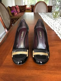 pair of black leather loafers Vancouver, V5S 1P4