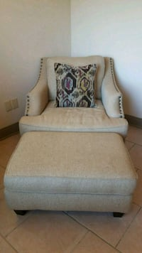 Brown and white fabric padded sofa chair Baton Rouge