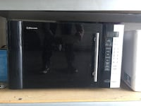 black and white Emerson microwave
