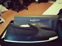 black and grey Bugatchi slip-on shoe