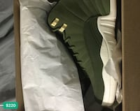 Pair of black air jordan 12 shoes with box