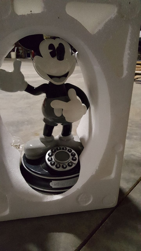 black and white Mickey Mouse rotary phone