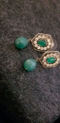 Silver earing with emerald drop