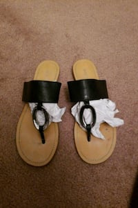 pair of brown-and-white leather sandals El Paso, 79938