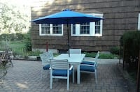 white and blue patio table with umbrella set