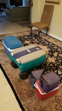 green and gray plastic pull wagon