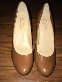 Pair of women's brown leather heels