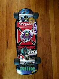 black, blue, and red Tony Hawk skateboard